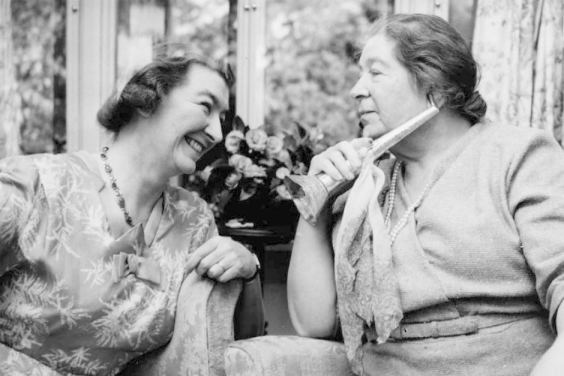 Ethel Anderson listens to a friend using her silver, moonstone-encrusted ear trumpet