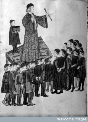 Charlatan with assistants, standing on table and addressing a crowd. Miniature 15th century