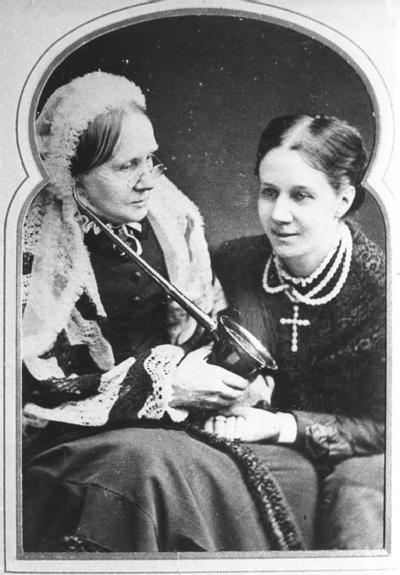 Mary Greg (was Mary Priscilla Needham) and daughter Amy Greg sitting beside her.